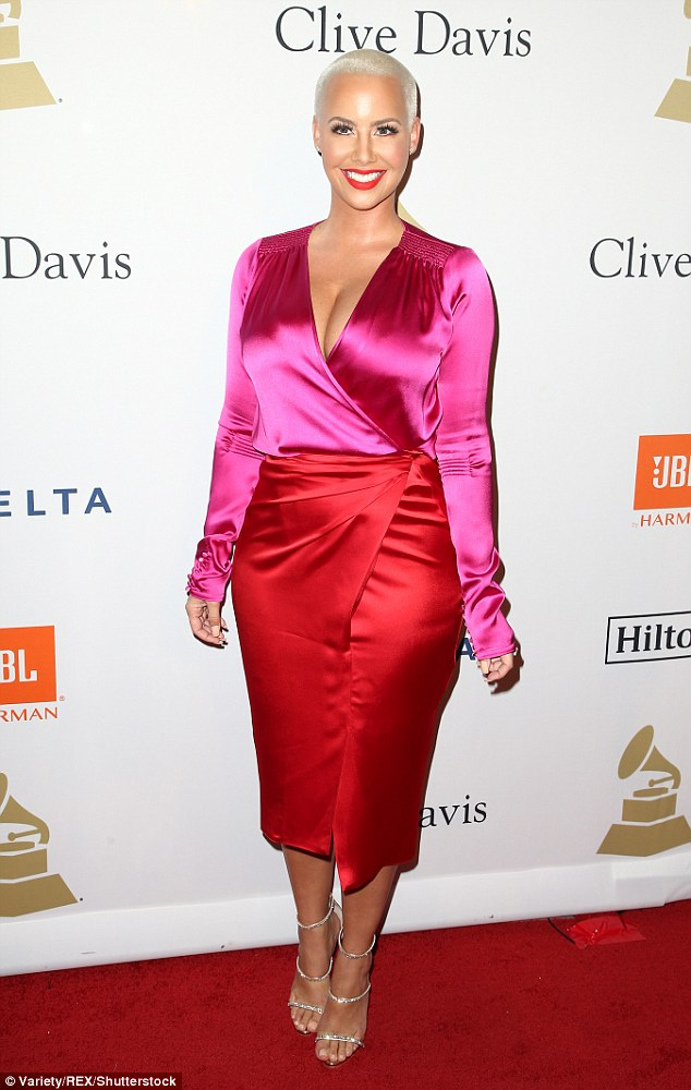 All smiles and no tears! Amber did not look like a lady reeling from a break-up as she hit the star-studded pre-Grammy bash