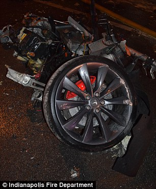 Ripped up: One witness said a wheel shot by his own vehicle after the explosion. An investigation into the crash is ongoing