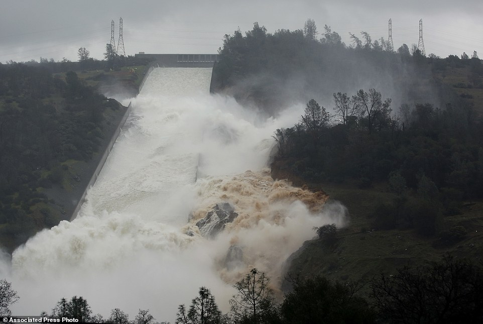 Overflow: Officials said on Sunday night water falling over the Oroville Dam's spillway has stopped as Oroville lake levels dropped low enough