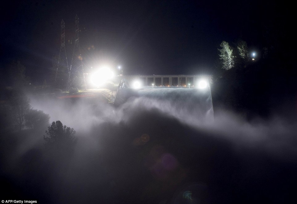 Fight: This long exposure photograph shows the Oroville Dam discharging water at a rate of 100,000 cubic feet per second over a spillway as an emergency measure