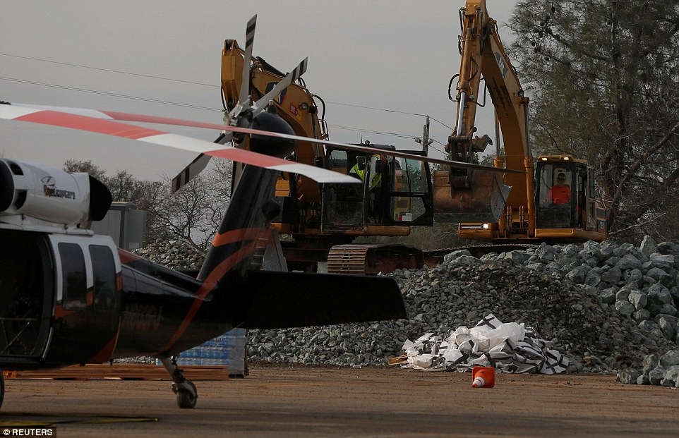 Brutal fix: Rock is prepped to be used on the Lake Oroville Dam to plug the hole in the spillway that almost imploded
