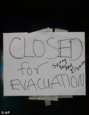 A closed sign is displayed on the door of Papaciito's restaurant due to an evacuation order Sunday, Feb. 12, 2017, in Marysville, California