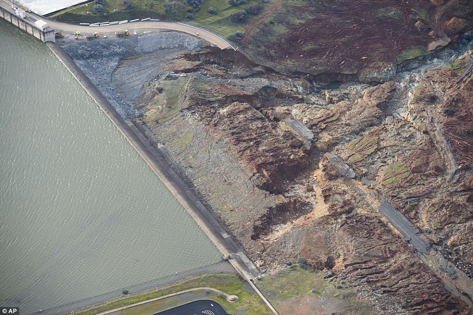 Destruction: An aerial photograph shows the damage done to the area surrounding the emergency spillway at Oroville Dam after it nearly collapsed on Sunday