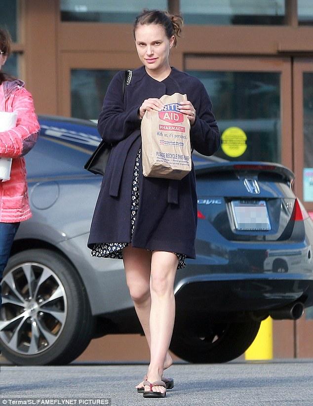 Natalie Portman Covers Baby Bump In Coat And Mini Dress