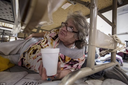 Sharon Dalton completes a crossword under a table in Bangor Community Hall in Bangor, California, on Monday
