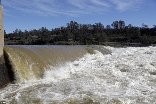 The Feather River which is at the foot of the dam flowed with force on Tuesday as it resisted floods