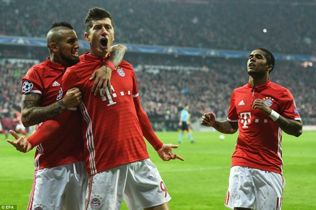 Robert Lewandowski roars after scoring Bayern's second goal as Arsenal were overpowered in the Champions League clash