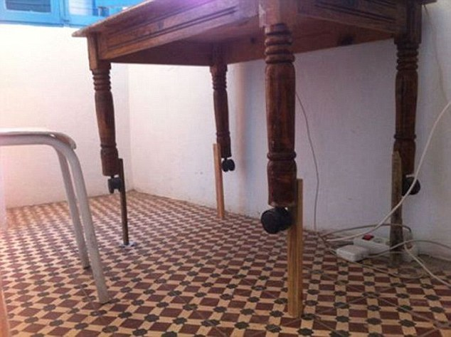 Rather than buying a new table you can just stick some wood on the legs to make the one you have higher