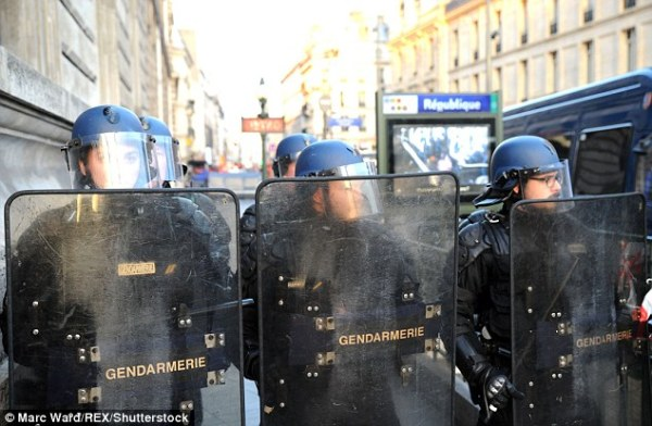 Paris protesters tear gassed in clashes with police ...