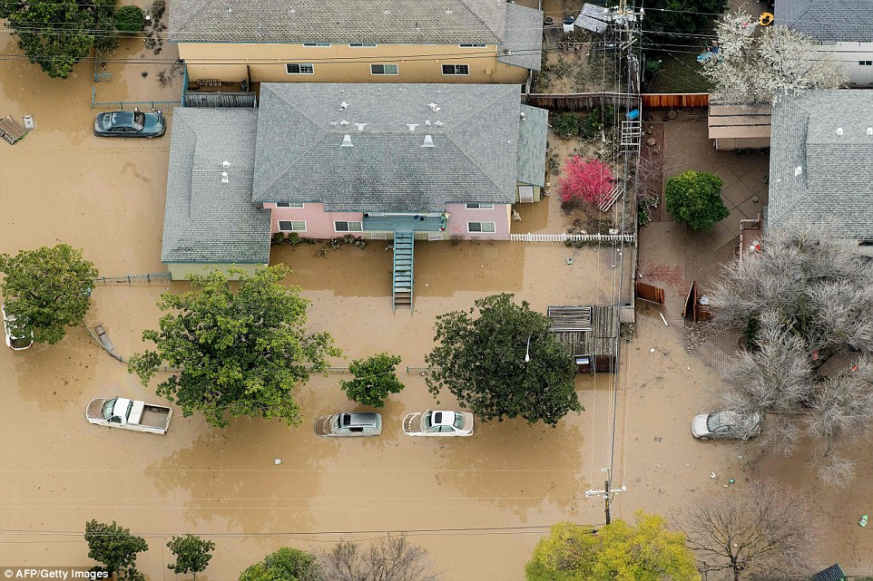 Some San Jose residents complained that the first they knew of the danger was on Wednesday when they saw neighbors being rescued from their homes in boats. Above, one home and surrounding cars is submerged in flood water