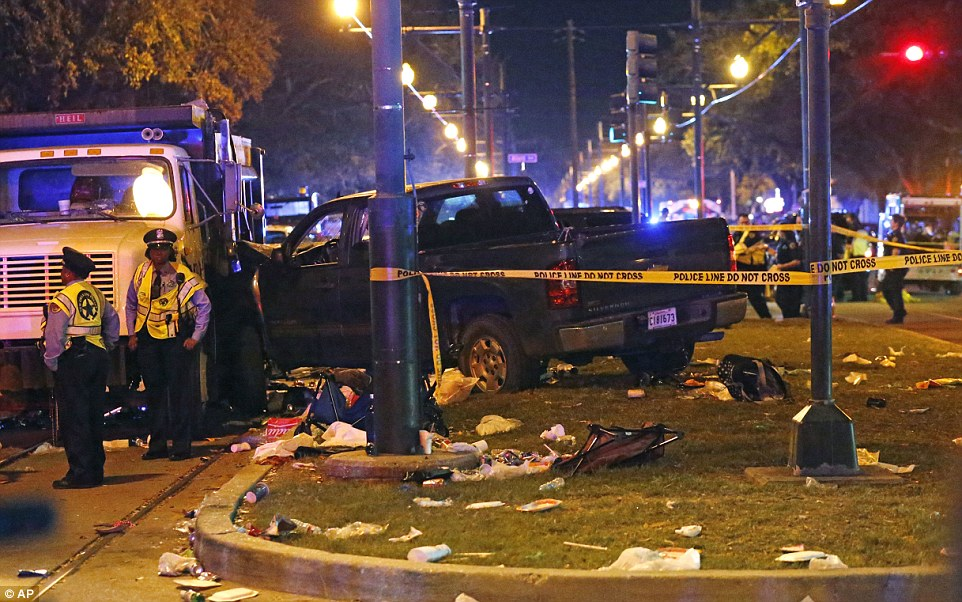 Witnesses saw grey Chevrolet pick up truck veer into the crowd after crashing into two vehicles