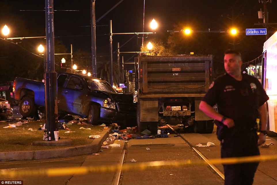 A vehicle is seen crashed along the Endymion parade route at Orleans and Carollton during Mardi Gras