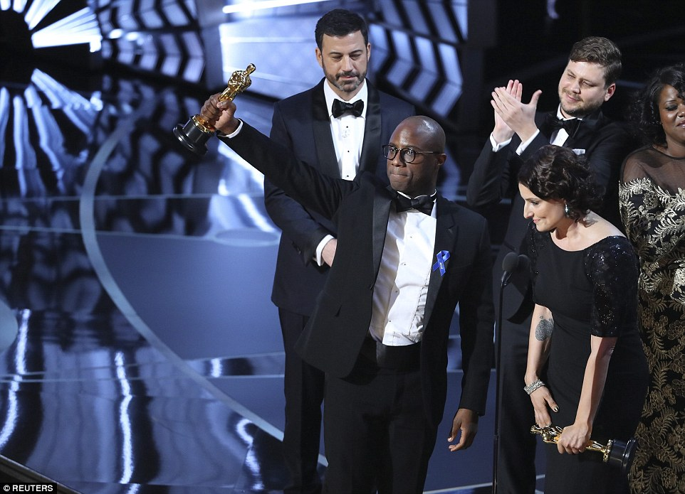 Writer and Director Barry Jenkins of Moonlight triumphantly held his Oscar up after the epic mishap