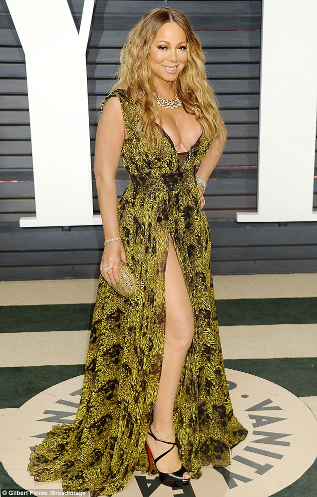 Killer footwear: Adding height to her glamorous ensemble, Mariah rocked a pair of black cross-strap platform peep-toe heel