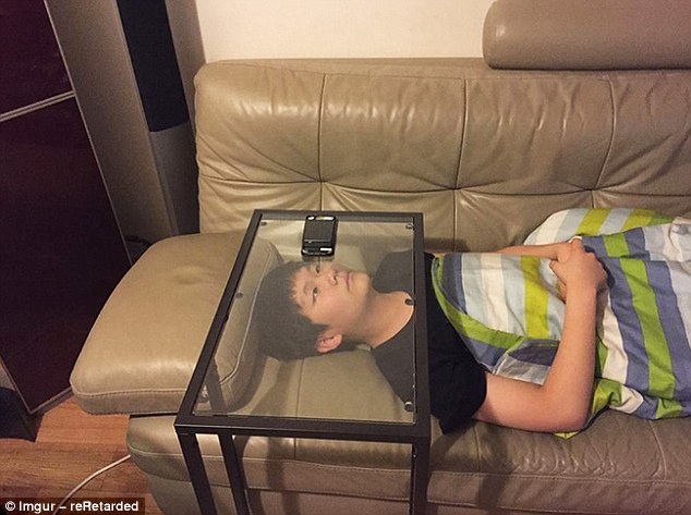 How to watch something on your phone without holding it aloft... strategic use of glass furniture of course