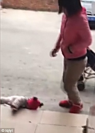 The beginning of the footage showed the crying baby was lying on the floor weakly
