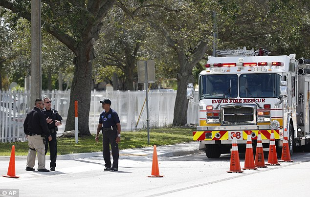 The Charles E. Smith Jewish Day School in Rockville, MD, and the Gesher Jewish Day School in Fairfax, VA, also received telephoned bomb threats, in addition to centers in Staten Island, Tarrytown and New Rochelle, NY. Pictured: Authorities at the Davie, Florida day school