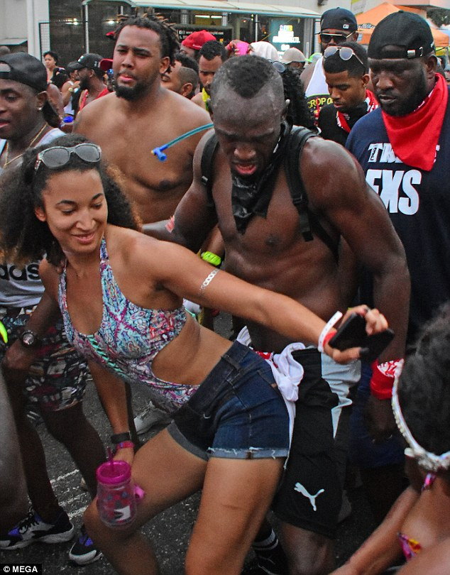 Another one: Usain showed off his moves as he got down and dirty with a fellow carnival goer