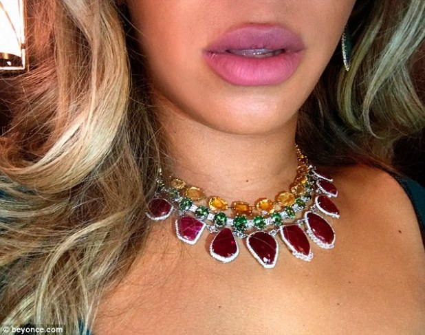 Ready for her close-up: The chart-topper shared an image of her beautiful red, green, and yellow choker necklace