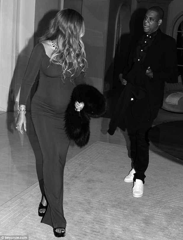 Date night: In another sweet black-and-white snap, the rapper and his leading lady can be seen strolling beside each other