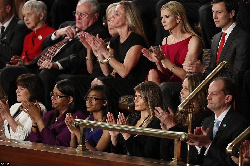 The first lady kept a straight face as she applauded with her guests as her husband spoke from the Speaker's rostrum