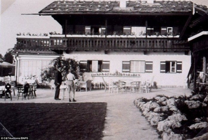 The album, which also includes an image of the Berghof's garden terrace, pictured above, is expected to fetch £18,500 when it goes under the hammer