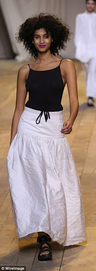 Model parade: The presentation was a fun-filled affair, with models clad in solely black and white looks from the new collection