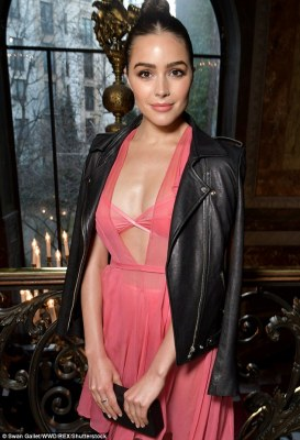 Oh my! The 24-year-old former beauty queen looked phenomenal in the slinky pink gown which gave a generous glimpse at her barely-there lingerie worn underneath