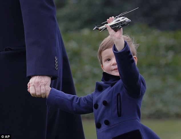 Three-year-old Joseph Kushner clutched a mini Marine One model toy as he boarded the real thing on Friday