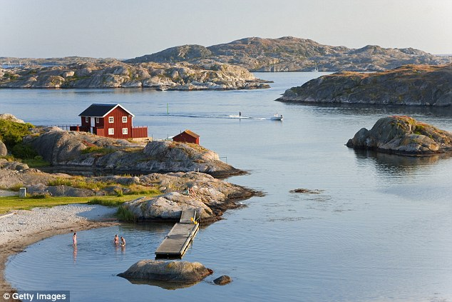 The idyllic island of Tjorn in Bohuslan, on west coast of Sweden,as a family paddle in the water