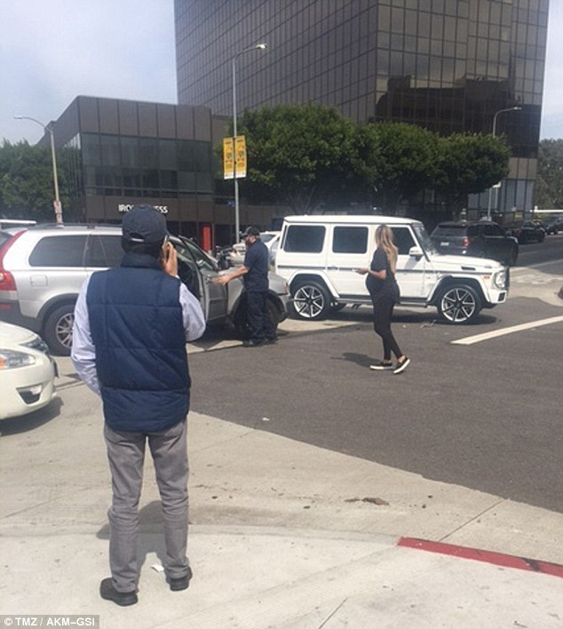 Aftermath: The hit-maker walked on the street beside her car