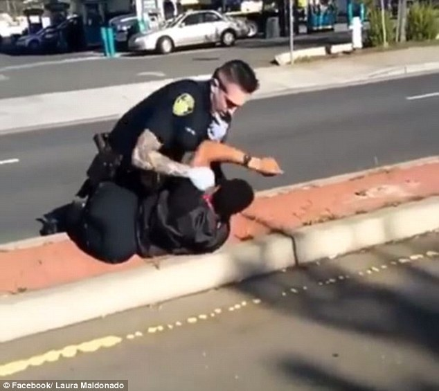 Shocking:A shocking police take down in California that was caught on camera has witnesses criticizing the officer for the handling of the situation, as some say he went too far (scene above)