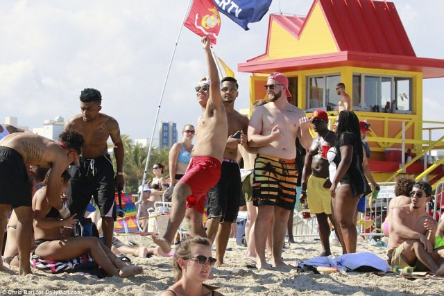 A group of men celebrated Spring Break together under proudly displayed flags brought out for the occasion