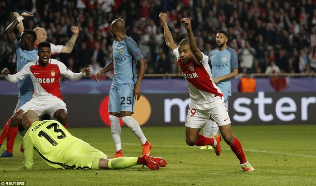 Mbappe lifts his arms high in celebration after giving Monaco a glimmer of hope after a defensively-poor first leg display