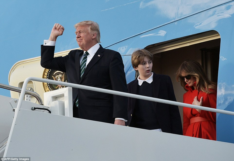 Trump raised his fist as his family disembarked Air Force One ready for another weekend at Mar-a-Lago in Florida