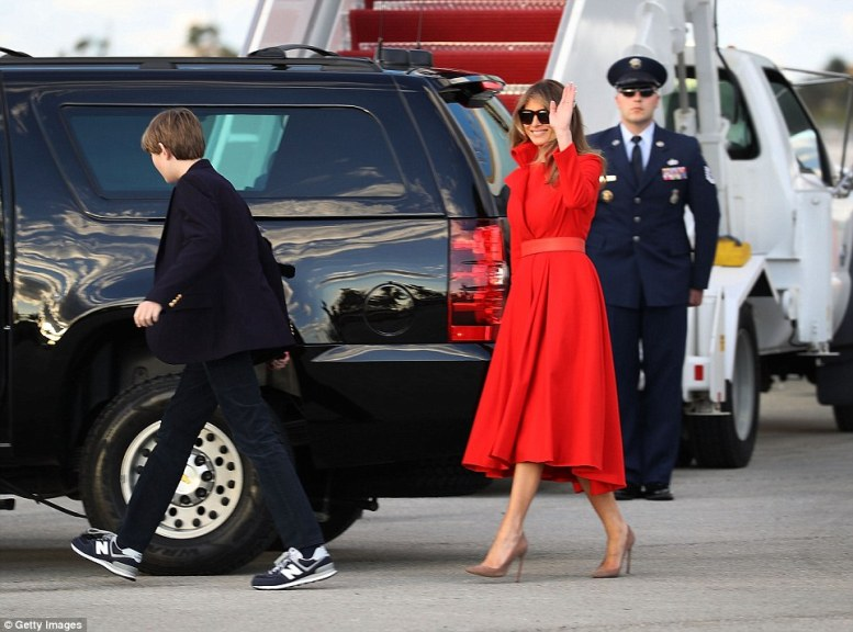 President Donald Trump's wife Melania Trump and their son, Barron Trump walk to their vehicle after arriving together on Air Force One