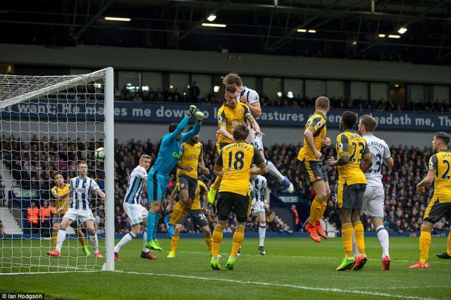 Dawson rises above Arsenal captain Laurent Koscielny to meet the ball with his head and put it in the back of Arsenal's net