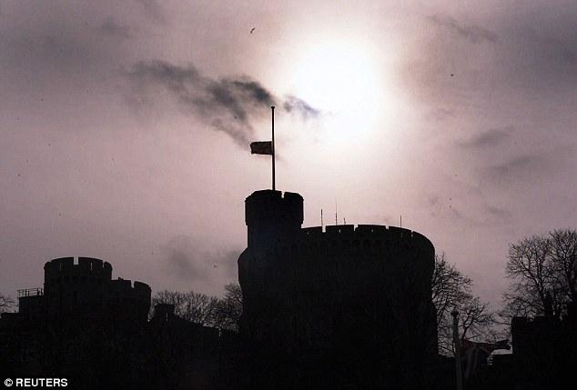 Vigil: The British flag flew athalf mast over Windsor Castle in Windsor after the death of Princess Margaret, the sister of Queen Elizabeth II in 2002