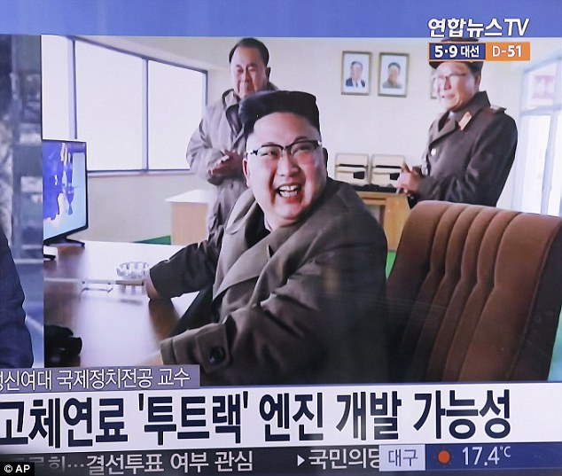 Having a blast: North Korean leader Kim Jong Un at the country's Sohae launch site yesterday