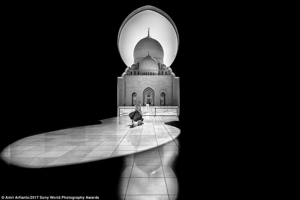 Called 'Walking in the Light', this image by photographer Amri Arfianto captures a woman at The Sheikh Zayed Grand Mosque in Abu Dhabi crossing through a keyhole-shaped patch of sunshine