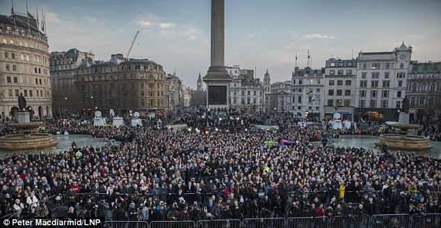 Standing together: Thousands gathered in London's Trafalgar Square today to pay a defiant tribute to those who lost their lives in the attack