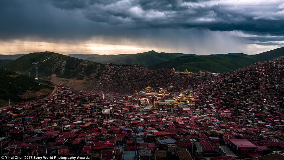 The skies darken as a storm approaches Larung Gar in Sichuan, China, home to the Five Sciences Buddhism Academy