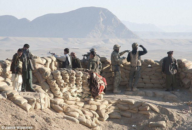 Troops from Badger Squadron, 2RTR, pictured at a militia camp overlooking Peace Street, a new road being built to Sangin in Helmand Province, Afghanistan