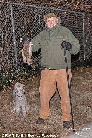 Here is Reynolds with his dog's nightly catch