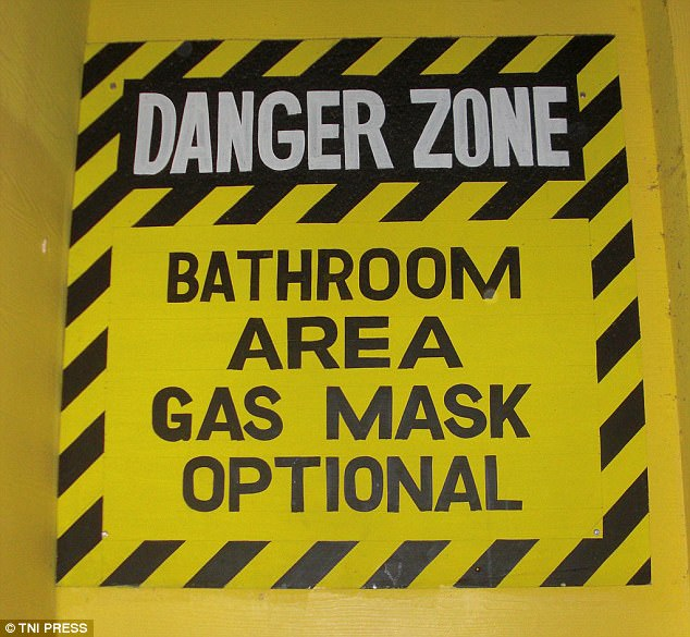 In this sign the establishment jokes that customers may need a gas mask to enter