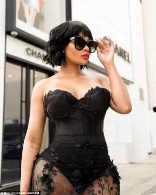 Showing off: The 28-year-old modelflaunted her curvaceous figure in a revealing ensemble including strapless corset bodysuit and see-through skirt