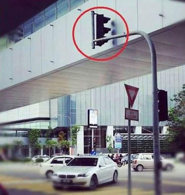 These traffic lights might not be much help considering they've been blocked by a building