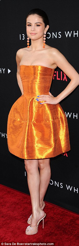 Big moment: The Hands To Myself star wore a yellow iridescent bandage dress which glowed gold in the light