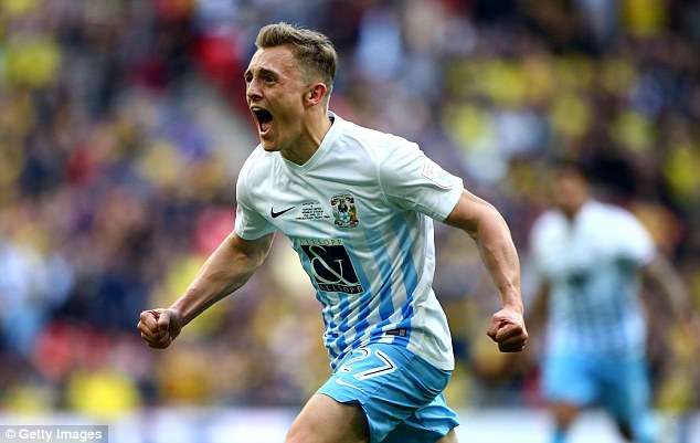 An elated Thomas races away to celebrate as Coventry take another step towards victory