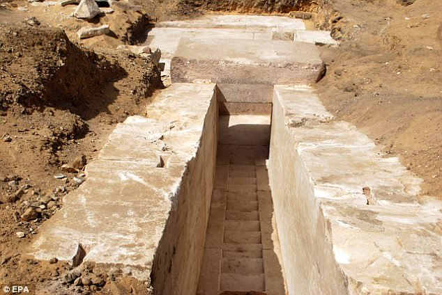 Blocks of stones and the beginning of a corridor which were discovered are shown in photos provided by the ministry